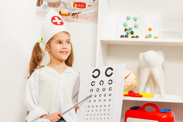 Beautiful girl playing oculist at medical office