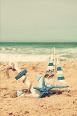 anchor, sailboat on sea sand and ocean horizon.
