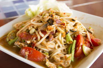 Papaya salad, Thailand foods that are spicy, a dish for a meal