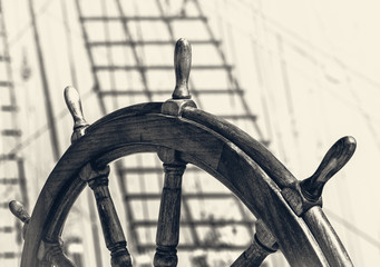Steering wheel of old sailing vessel in retro style.