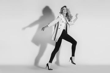 The emotional model running in leggings on a white background.