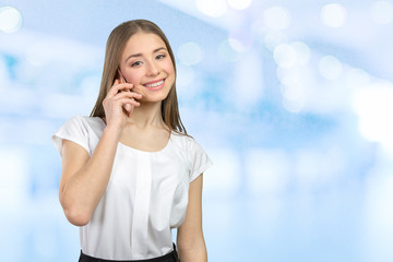 Young elegant woman talking on mobile phone