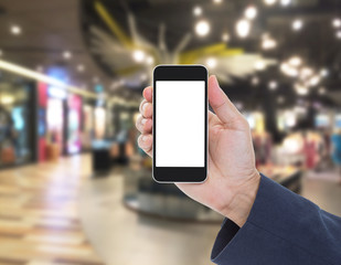 Hand holding blank screen mobile phone with blur shopping mall b