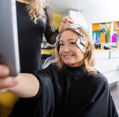 Happy Woman Talking Selfie In Beauty Salon