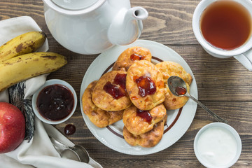 Banana cheese scones for Breakfast with jam,sour cream.Tea, fruit.