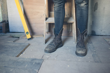 Feet of worker on construction site