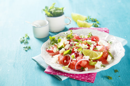 Watermelon salad with feta cheese and onion