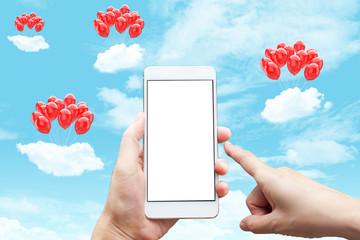 Business conceptual- Focused on left hand holding mobile with bunch of red balloons on mobile screen and surrounding with sky background