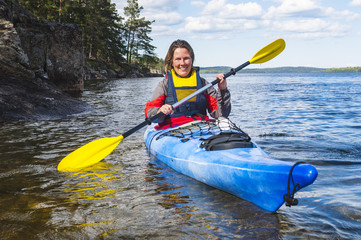 Mature woman kayaking