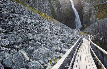 Wooden path leading to waterfall
