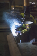 Welder working in workshop