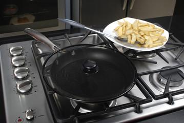 frying potatoes in the pan