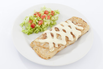 Delicious burrito brunch of sausage  on white plate