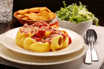 Lumaconi pasta with tomato sauce, bruschetta and salad