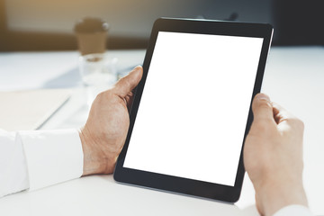 Close-up of professional businessman holding blank digital tablet with copy space for your design or content, mock-up of template tablet pc, flare light