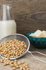 Soy milk,tofu, and soybeans, on wooden background