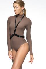 Attractive girl in brown bodysuit and sword belt