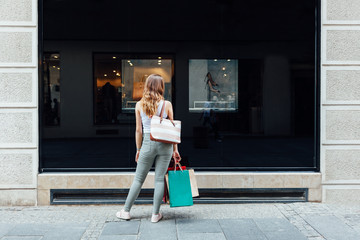 Women with colorful shopping bags