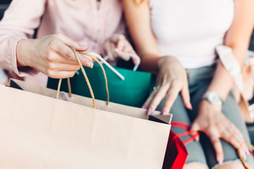 Woman opening shopping bags after purchase