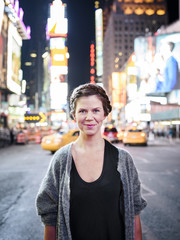 Portrait of smiling woman, Times Square, New York City, USA