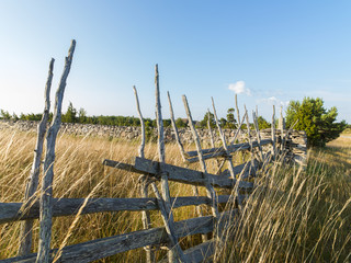 View of wooden fence in field against sky