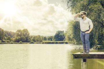 watching man at the lake