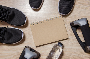 Exercise Equipment on wooden background, Fitness concept.