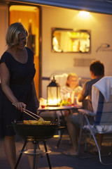 Family having barbecue at night