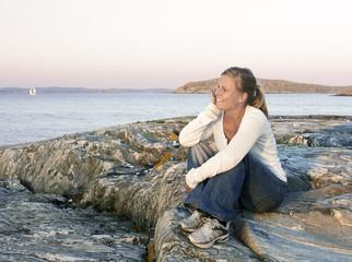 Smiling woman looking at sea