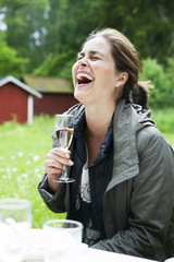 Laughing woman with wine glass