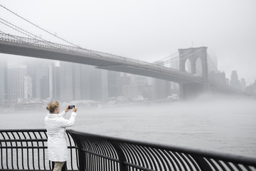 Woman taking picture of bridge
