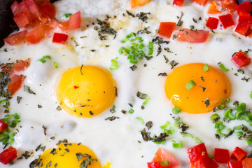 Fried egg, pepper, onion and herbs