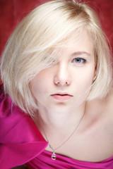 Portrait beautiful woman in dress on grunge wall