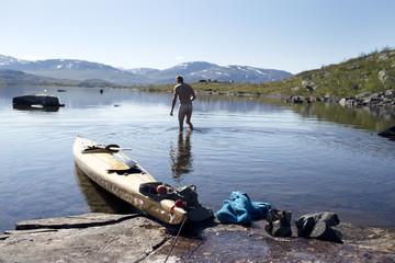 Person kayaking at sea