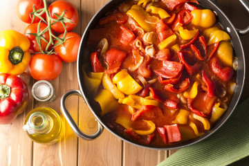 yellow and red pepper cooked in the pan