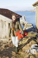 Smiling woman at sea
