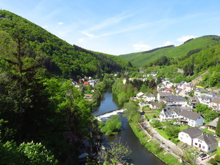 Town on Vianden with river Our and hill tops