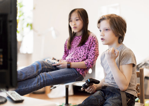 Boy and girl playing video game