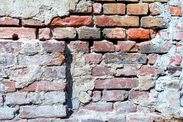 old damaged red brick wall - background