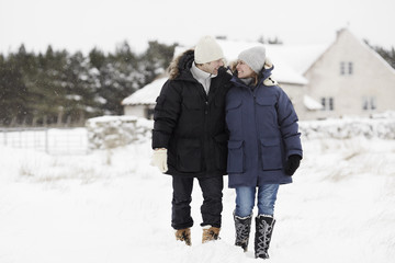 Couple walking at winter