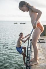Boy and girl at sea
