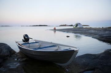 Boat on coast at dusk