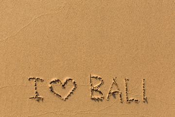 I love Bali - the inscription by hand on the beach sand.