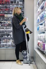 Woman with broken leg in shop