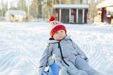 Baby on sledge