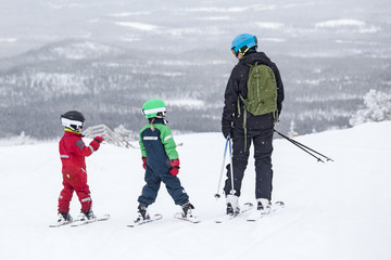 Father with children skiing