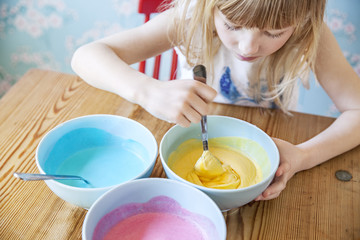 Girl mixing food in bowl