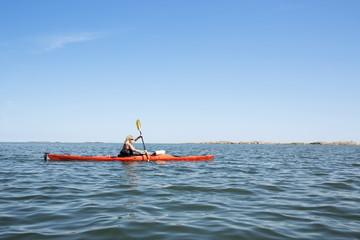 Woman kayak on lake