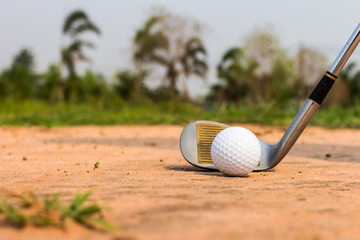 Golf Ball in Trap with Sand