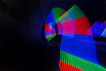 Primary colored LED lights lighting up a dark tunnel